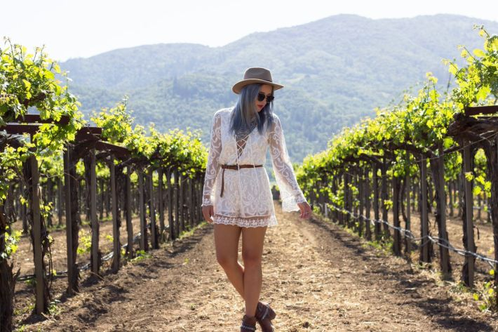 Everything about Bryn's outfit is perfect for this outing! From her flower child romper to her closed toed boots that keep that winery dust at bay.