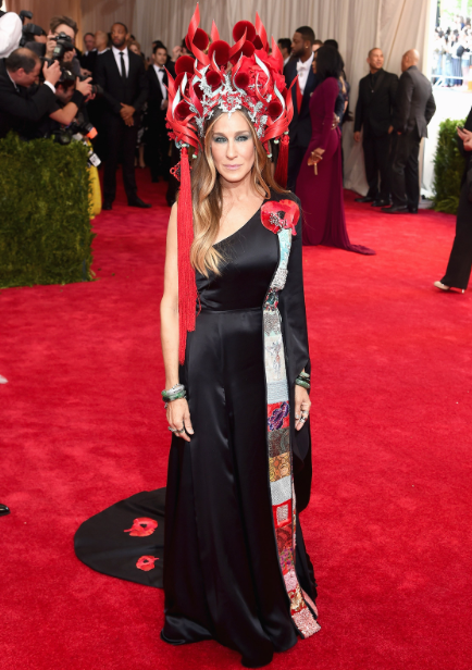 We have to take a moment to acknowledge two things. First, this headdress. I mean, Sarah Jessica Parker has never been one to shy away from a costume, and her elaborate headwear proves it. Second, her dress is from H&M! This is the fashion company's first appearance on the Met Gala red carpet, and on SJP no less.