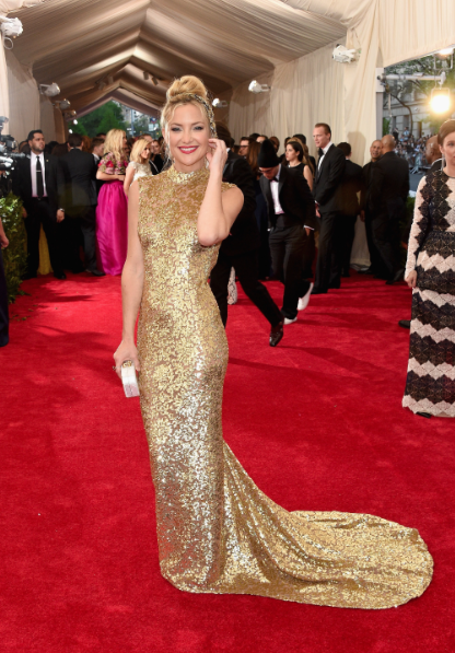 Seriously, who doesn't love this woman? There is something to be said for the classic gold sparkly dress, and she's saying it just standing there. The Eastern-inspired cut is a subtle take on the theme of the evening.