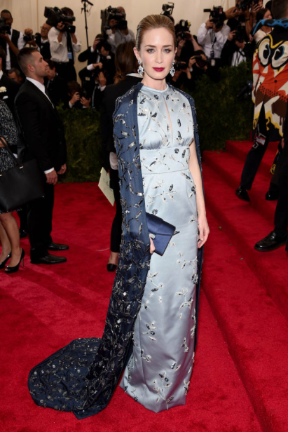 Emily Blunt's gorgeous Prada dress is a delicate nod to the cheongsam (a dress form created in China) and she completes the look with a fierce red lip.